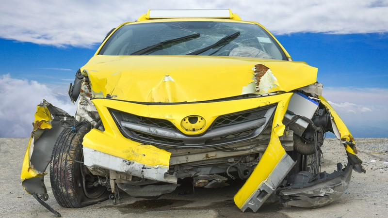 Crushed Yellow Car Before Professional Auto Body Repair