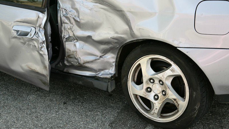 Crushed Grey Car Before Professional Auto Body Repair